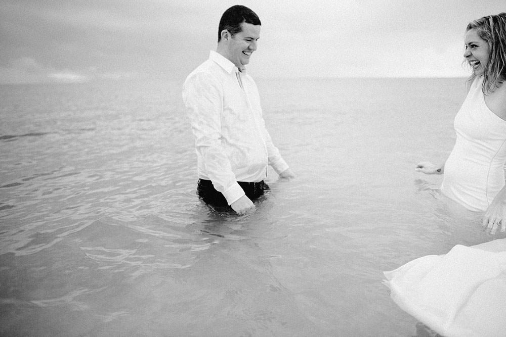 Royalton Riviera Cancun Wedding couple swim in ocean following morning