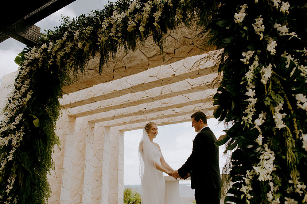 Royalton Riviera Cancun Wedding couple says vows at alter