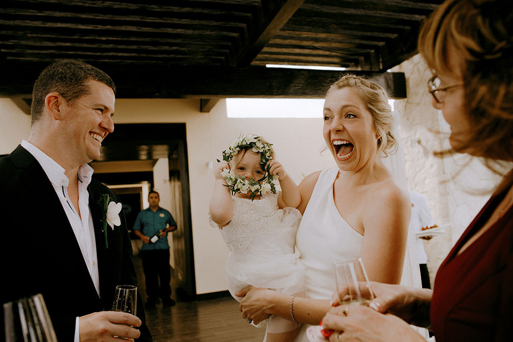 Royalton Riviera Cancun Wedding couple laughs with baby daughter