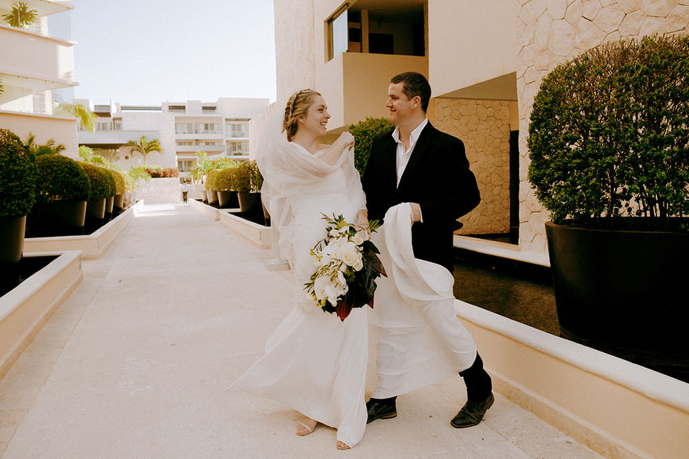 Royalton Riviera Cancun Wedding couple laughing with one another