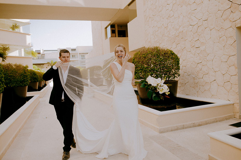 Royalton Riviera Cancun Wedding couple laugh candidly