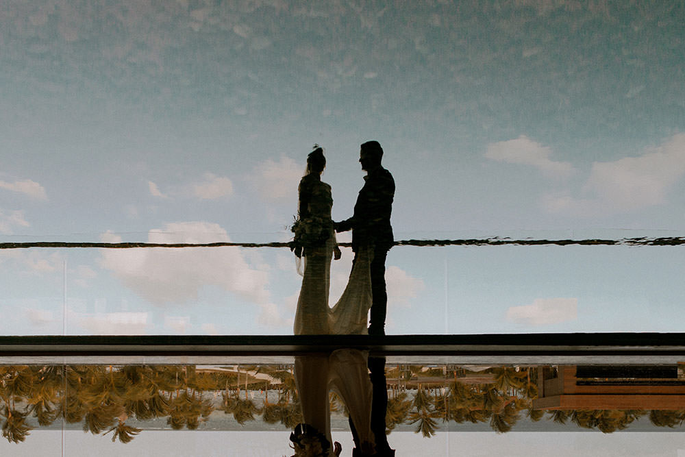 Royalton Riviera Cancun Wedding couple reflected in water