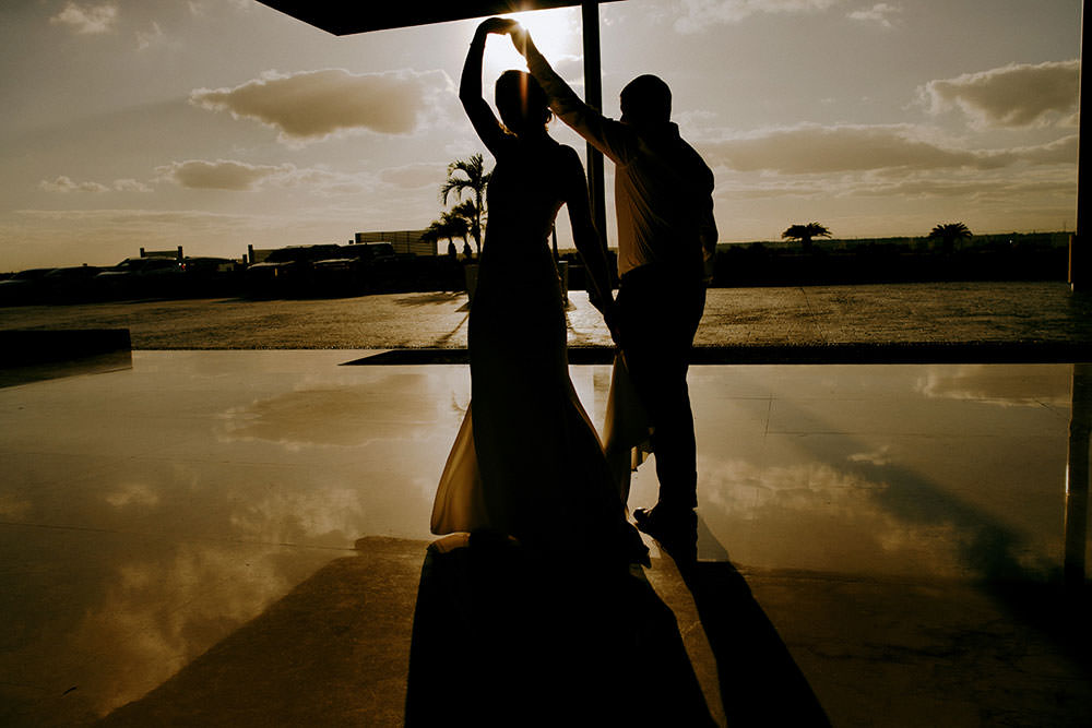 Royalton Riviera Cancun Wedding couple dance in sunset