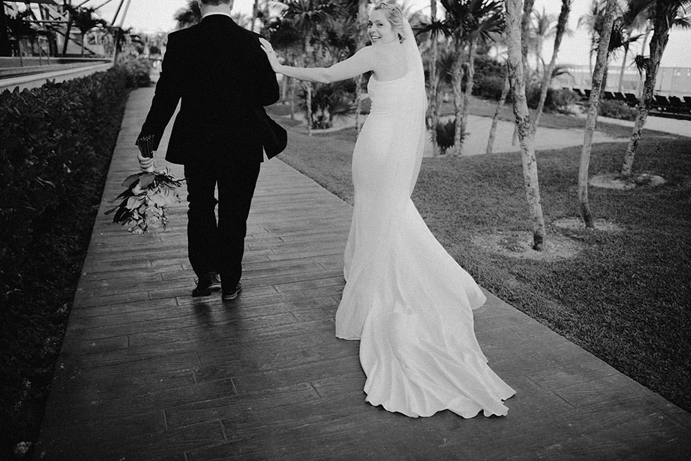 Royalton Riviera Cancun Wedding couple walk together