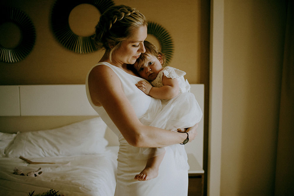 Royalton Riviera Cancun Wedding bride and her baby daughter