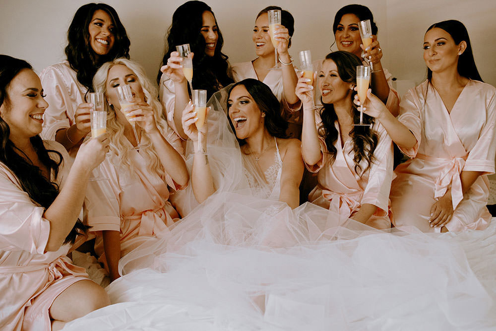 toronto bridal party portraits of group laughing together