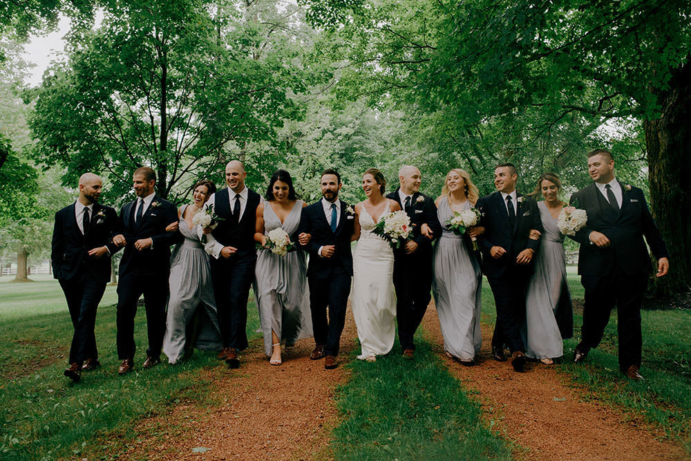 innisfil bridal party walk together laughing