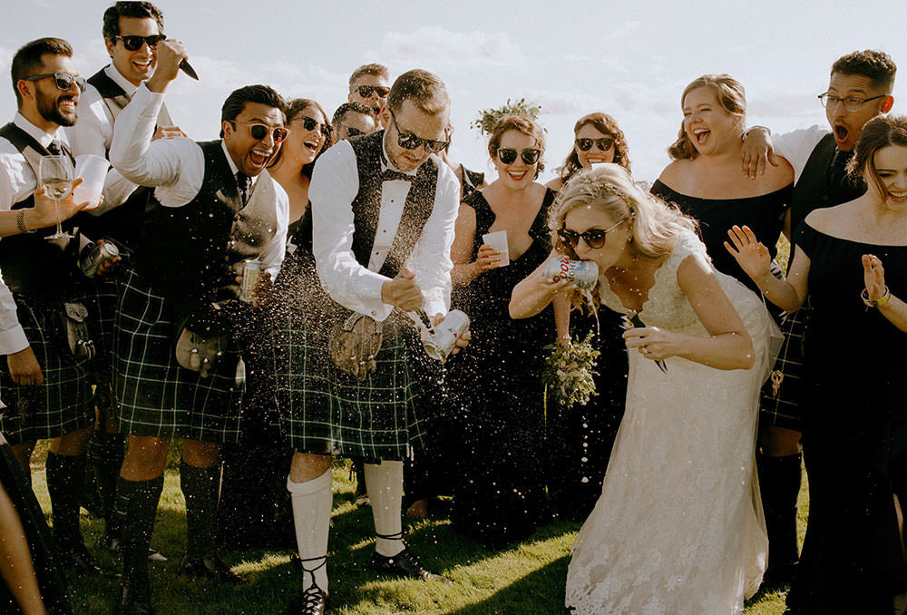 sudbury bridal party portraits of group laughing together
