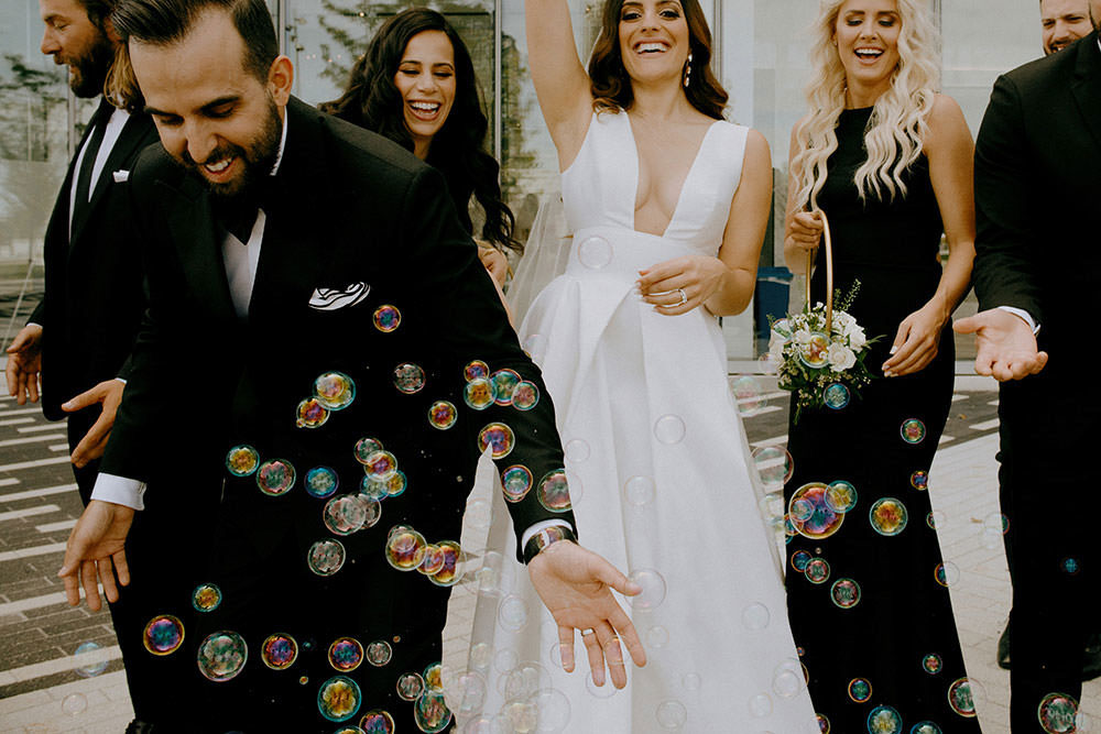 toronto bridal party portraits of them laughs together