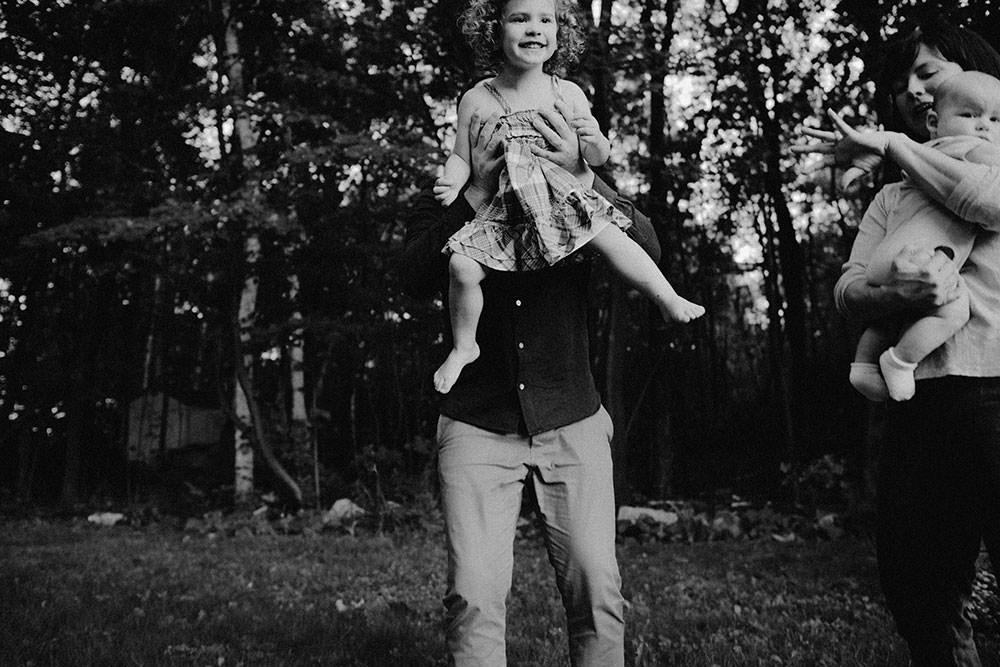 sudbury family portrait girl running and laughing