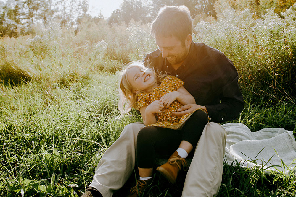 Sudbury family photography of father tickling daughter