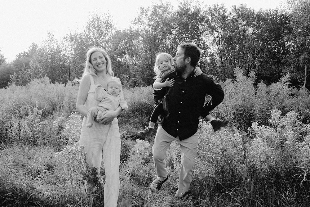 Sudbury family photography of family walking in flower field