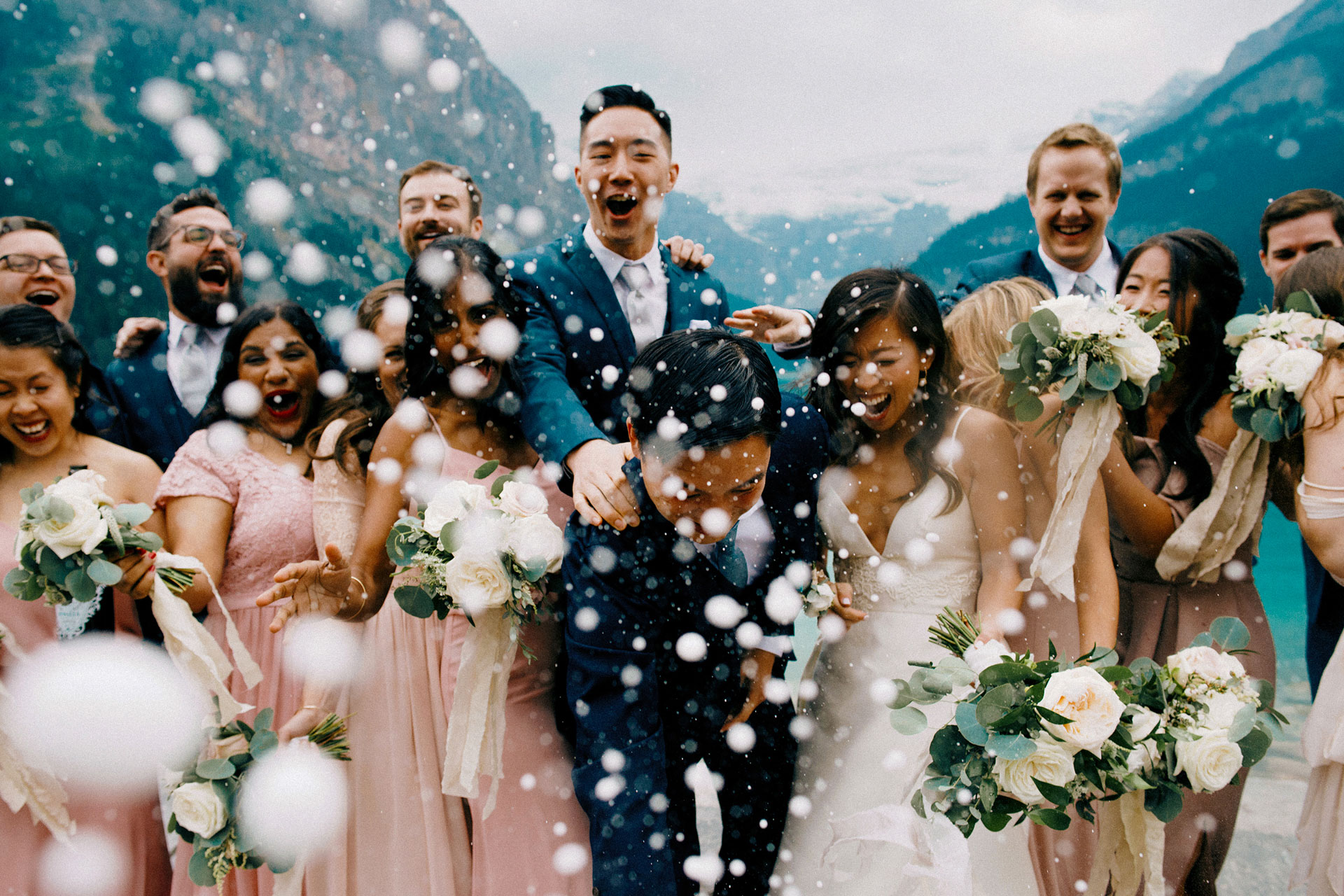 Fairmont Lake Louise Wedding Photography or bridal party doing a champagne pop for our Toronto Wedding Photography lenses