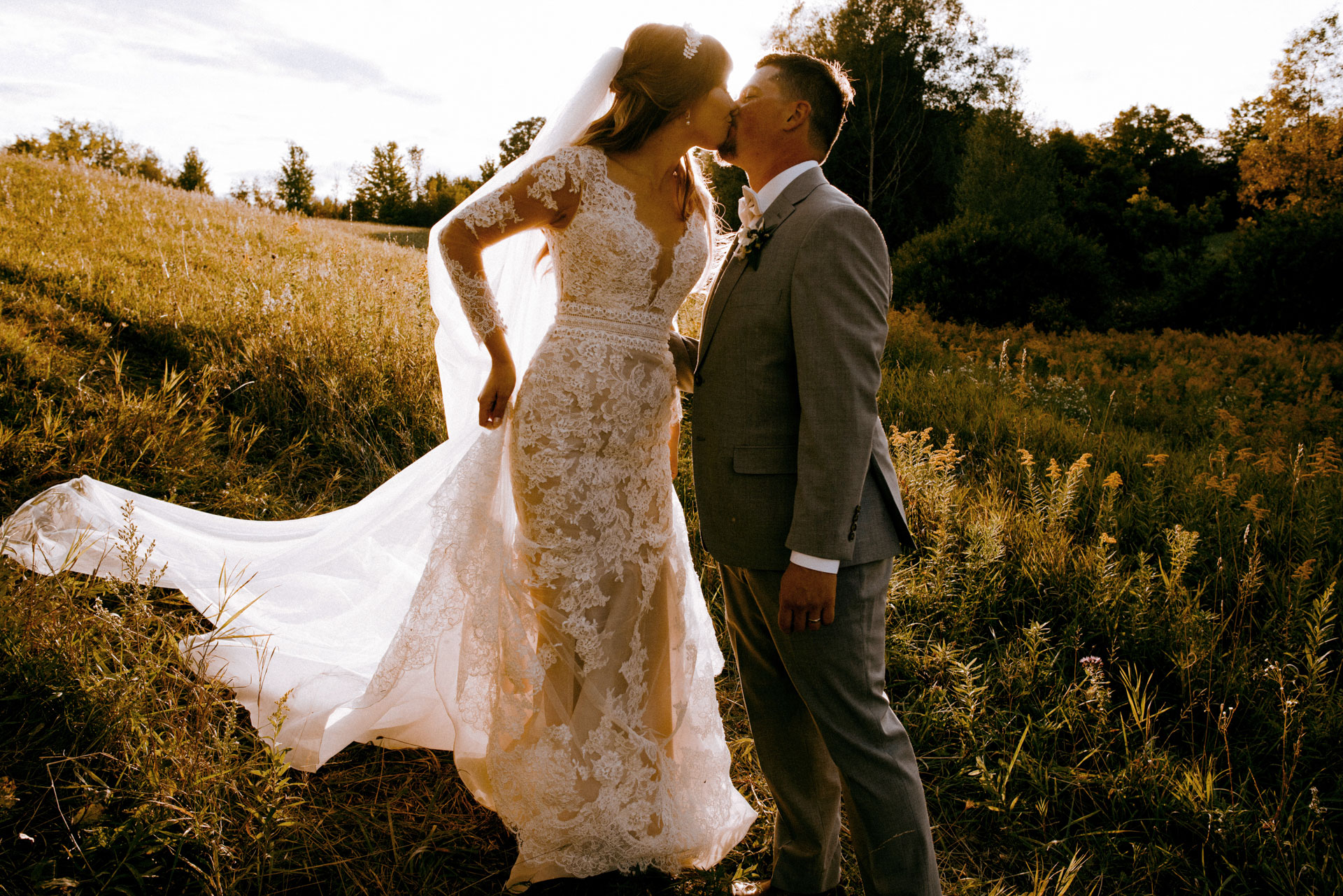 Toronto Wedding Photography of bride and groom kissing at sunset in innisfil after their vows