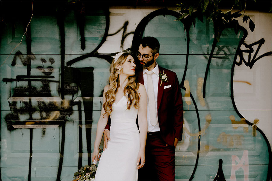 Toronto Wedding photography of bride and groom against a mural wall